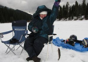 "Pat from England with her first ""Hard Water"" caught Rainbow."