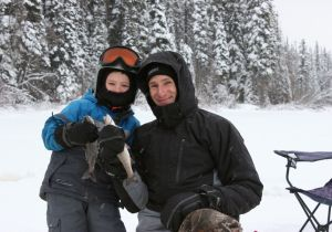 Steven and his son Cole enjoying a day of ice fishing.