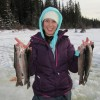 Carli with a nice catch of Rainbow Trout. Her first time ice fishing!