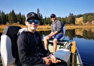Father & Son Enjoying a Day Fly Fishing a Small Mountain Lake