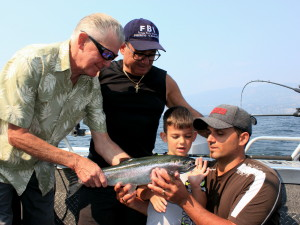 Family fishing on Okanagan lake with Rodney's Reel Outdoors