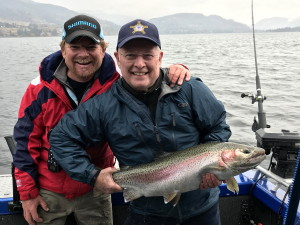 Rodney's Reel Outdoors guide Tim and guest with a Rainbow trout from Skaha lake