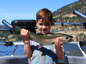 A young angler with his first Rainbow Trout!