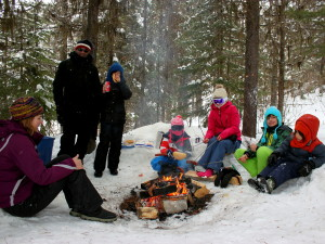 family ice fishing near big white